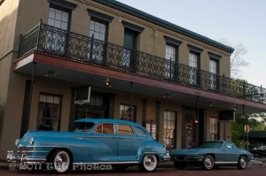 Antique cars sitting in front of the Historic Jefferson Hotel